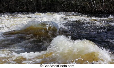 The rapid flow of the river 1 - Beautiful waves on rapids of...
