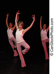 Dancers on stage - A group of three Caucasian female...