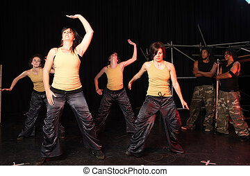 Dancers on stage - A group of four female and two male...