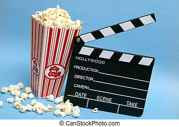 Movie Production - A tub of popcorn and a clapboard to...