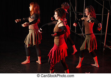 Dancers on stage - A group of four female freestyle hip-hop...