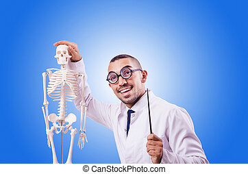 Funny doctor with skeleton against the gradient