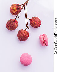Brunch of ripe lychee and lychee macaroons with leaf isolate...