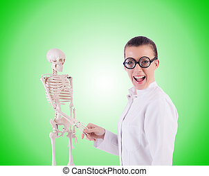 Doctor with skeleton against the gradient