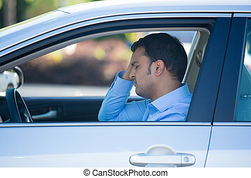 Driving man upset and stressed in car - Closeup portrait,...