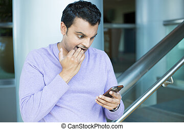 Nervous guy seeing bad news on phone - Closeup portrait,...