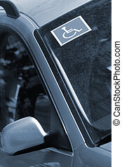 Disabled sign on front car window Vertical blue colorized...