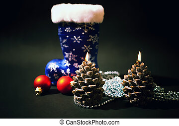 Christmas-tree decorations and christmas candles with dark...