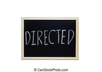 DIRECTED written with white chalk on blackboard.