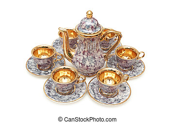 Set of chinaware - Kettle and six cups isolated on white