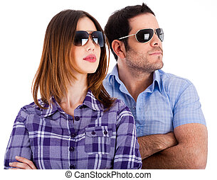 Fsshion models looking left with sunglasses