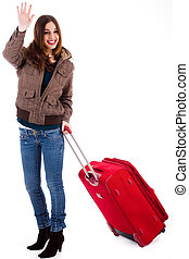 Attractive young women travelling with suitcase indoor...
