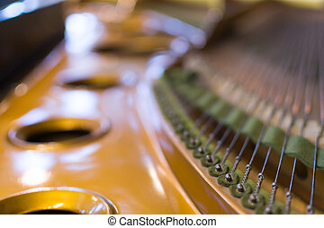 Grand Piano Strings in Closeup - Detailed image of the...