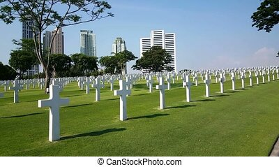 Manila, American Cemetery, rows of white crosses, wide shot,...