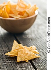 tortilla chips on old wooden table