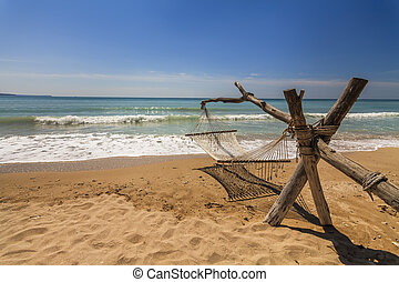 Hammock on the shore of the sea.