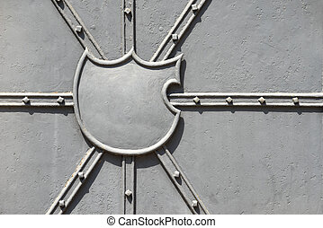 Empty blazon on a metal door - Empty blazon on a gray...