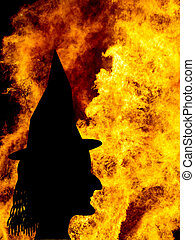 Witch face silhouette over fames, bonfire. Halloween etc. -...