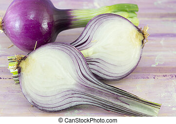Young garlic on a magenta wooden board - Fresh organic...