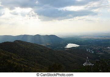 Buddha on mountain landscape