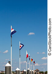 Line of Nautical Flags Under Blue Sky - A line of nautical...