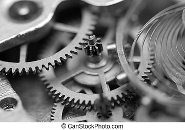 Black white background with metal cogwheels a clockwork....