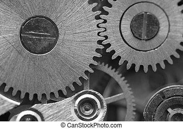 Black white background with metal cogwheels a clockwork...