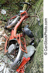 red moped inoperative abandoned in