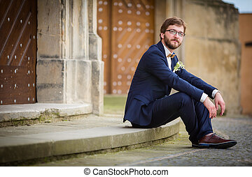 Handsome groom on his wedding day waiting for his bride in...