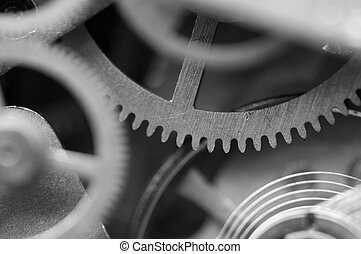 Black and white background with metal cogwheels a clockwork...