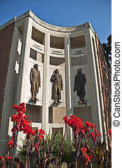 City Hall Downtown Charlottesville Virginia with red flowers...