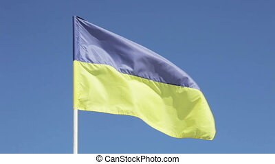 Ukrainian flag - On background of blue sky Ukrainian flag