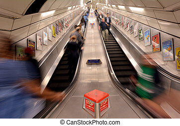 Passengers on London Underground escalator - LONDON, UK -...