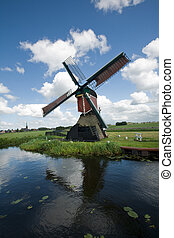 Mill in landscape - wipmolen in dutch landscape with...