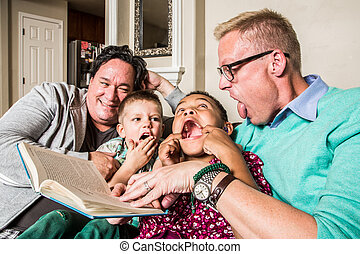 Cute Family Making Faces - Homosexual parents reading and...