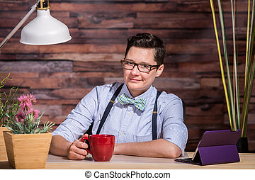 Butch Businesswoman with Coffee Mug - Smiling Dapper woman...