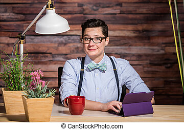 Flattered Woman at Desk - Flattered dapper woman with bowtie...