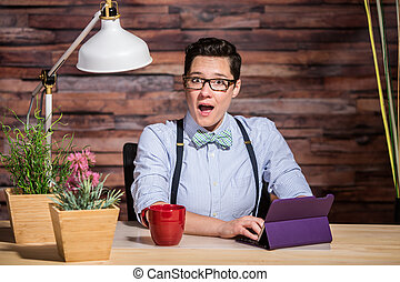 Excited Woman at Desk with Tablet - Surprised dapper woman...
