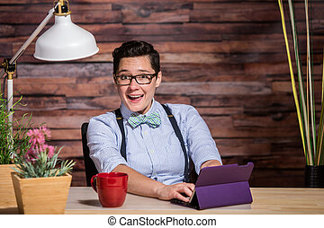 Laughing Woman Having Fun at Desk - Laughing dapper woman...