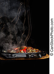 Flamed hot bbq on plate on dark background