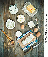 milk products on old wooden Sloley top view