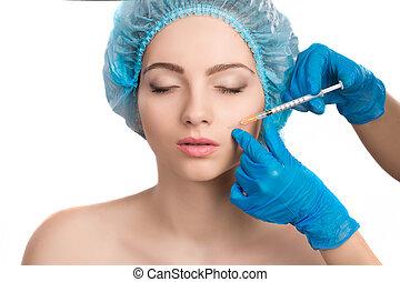 woman receiving botox injection - Young beautiful woman...