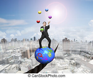 Juggling businessman standing on symbols ball balancing on...