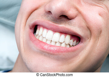Extreme close up of human male mouth showing teeth.