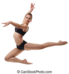 Beautiful female dancer posing in graceful jump - Beautiful...