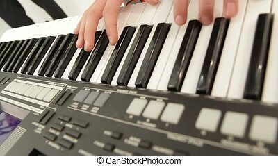 Piano Key - Rehearsal school band. Teenager playing the...