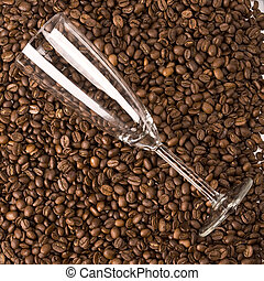 Glass on coffee - Glas of champagne on coffee beans...