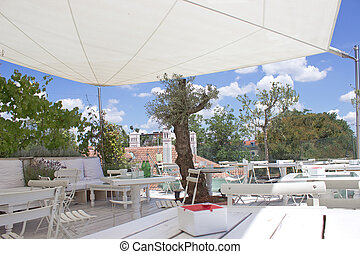 Outdoor restaurant terrace on roof with parasol