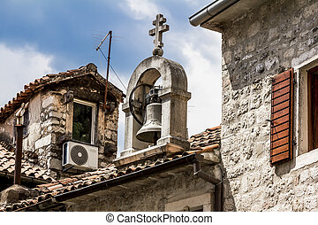 The bell on the roof in the old town of Kotor, Montenegro