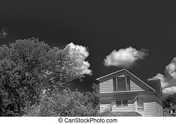 Home and Clouds - Clouds passing over home under blue sky\'s